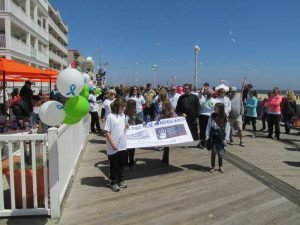 People walking on boardwalk in OCMD for Walk For Kids