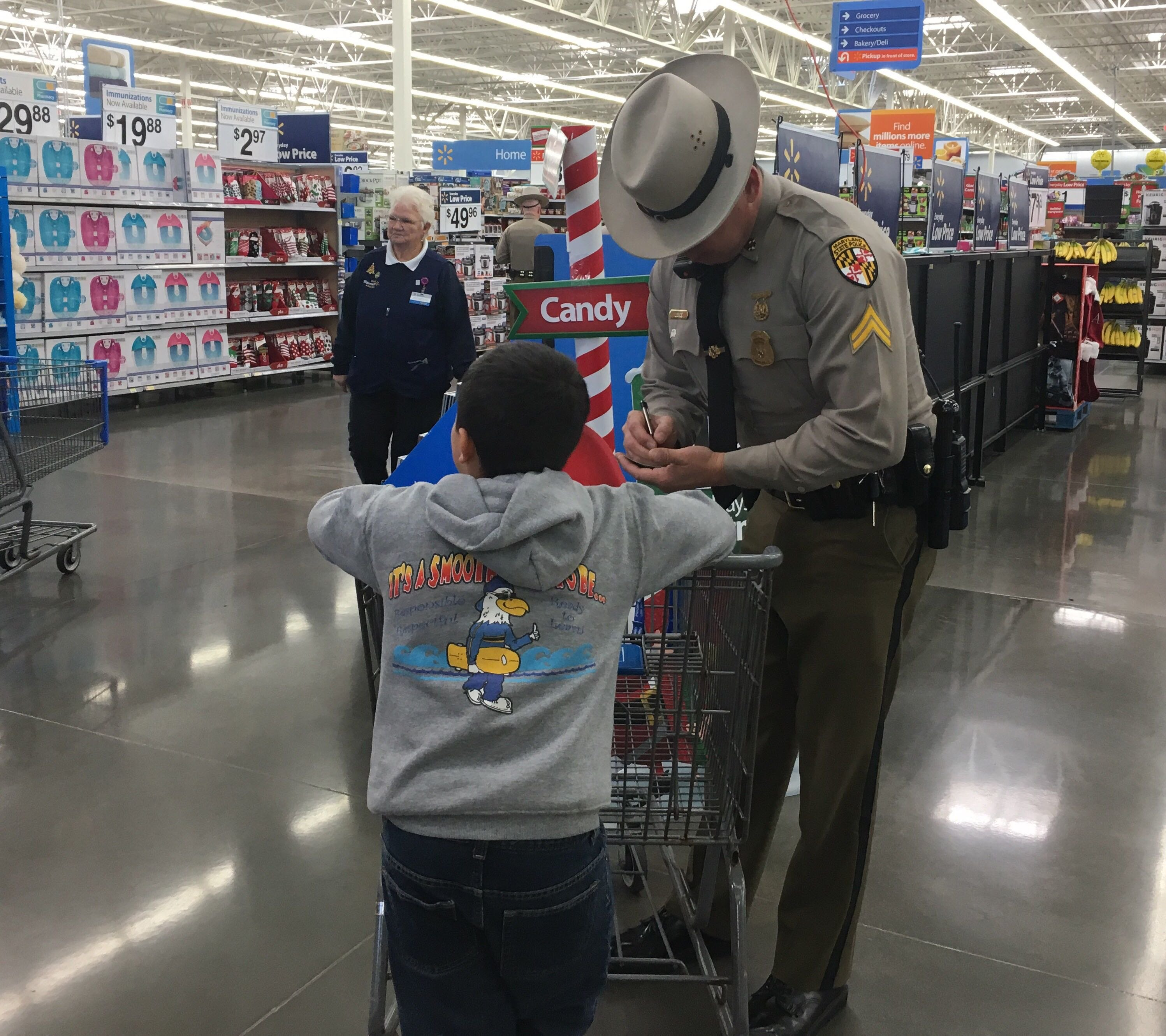 police officer helping child at walmart